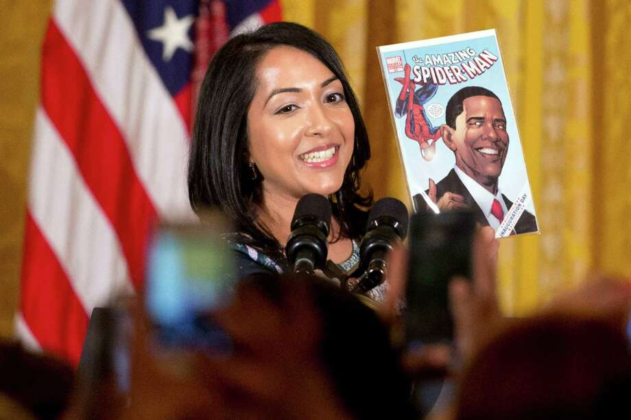 Anyone can be Spider-Man, attests Ms. Marvel co-creator Sana Amanat as she holds up a Marvel comic book featuring President Barack Obama during Women's History Month in March. Photo: Jacquelyn Martin, STF / AP