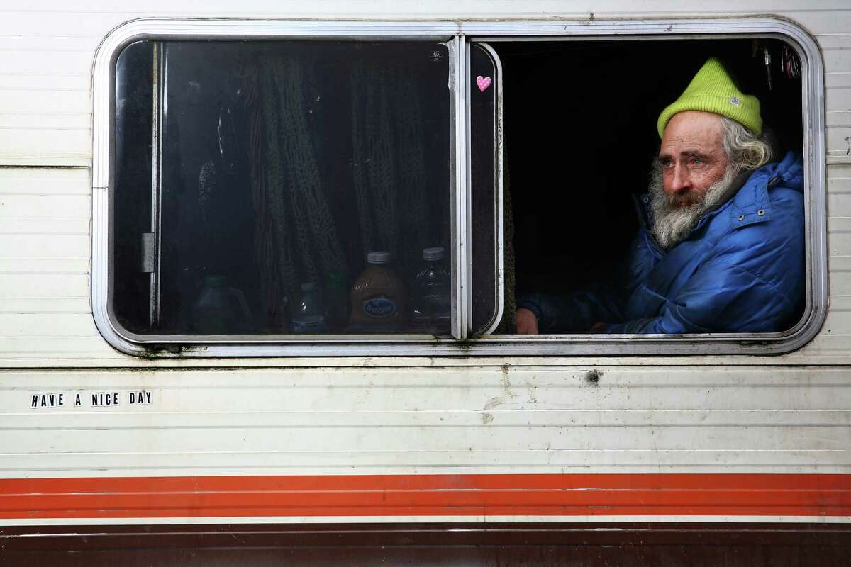 Robert Chamberlin, 62, likes to keep an eye on the neighborhood through the window of his RV to make sure people aren't stealing from the business nearby. He has lived on Colorado Avenue S for the past 11 years after an injury ended his career as a soup and sauce chef. He now has a cyst and cancer and it's hard for him to walk. He spends most of his time inside his RV playing Halo 2.