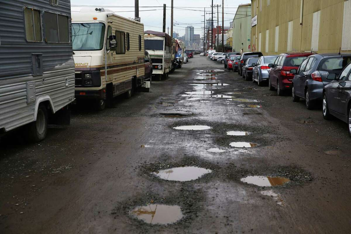 Mobile homes line the left side of Colorado Avenue S while cars belonging to employees of Starbucks headquarters and other businesses in the area line the right. Scenes like this are common in some Seattle neighborhoods, but in many cases, vehicles are given notices to move after 72 hours and then towed and impounded. Friday's ruling could mean the cars and other vehicles would have to be released immediately, even if towing and impound fees could not be paid.