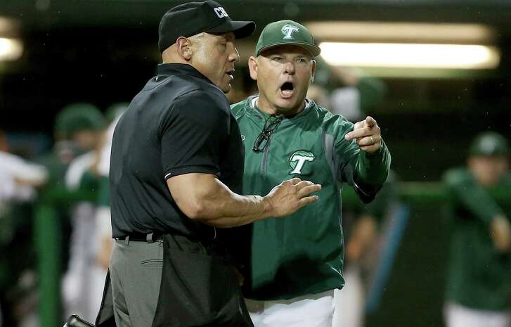 In this April 15, 2016 photo, Tulane baseball coach David Pierce argues an overturned fair ball during a game against Cincinnati at Turchin Stadium in New Orleans. Texas reached an agreement with Pierce to take over the Longhorns' program.