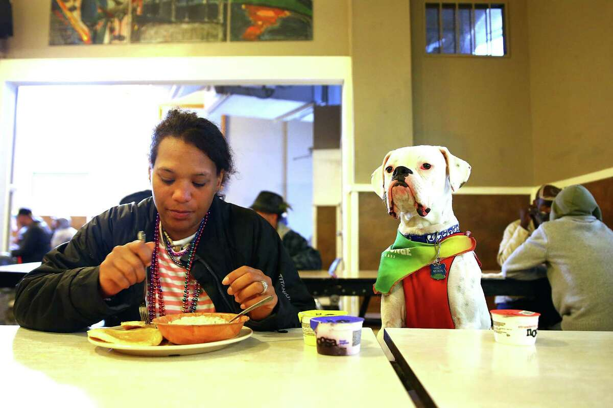 Seattle residents experience food insecurity at the same rate as the rest of King County, about 1-in-8. Here's a look at how the city's neighborhoods and neighboring communities compare. Above, Donna Nelson, sits with Lucky, as she eats breakfast at the Union Gospel Mission, June 29, 2016. Though UGM's downtown location is a men's only shelter at night, women are allowed to eat meals and stay there during daytime hours.
