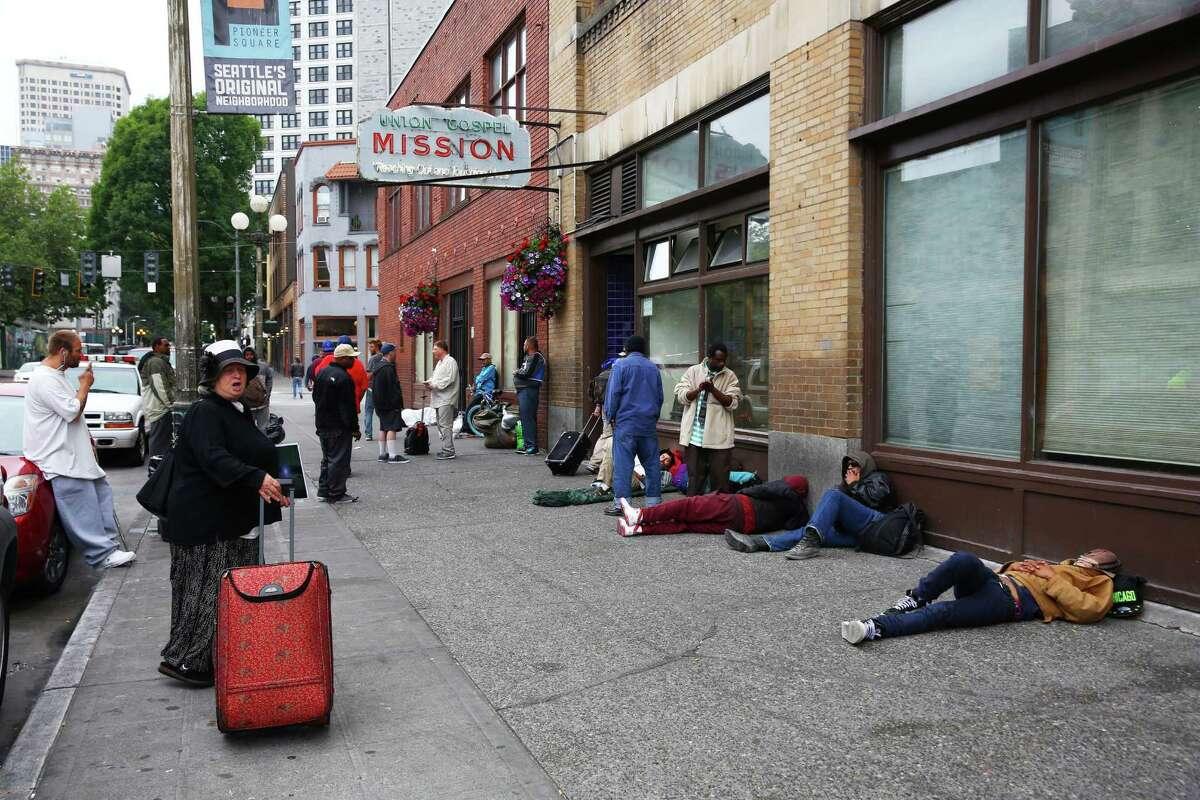 Homeless wait outside of Union Gospel Mission for breakfast, Wednesday, June 29, 2016.