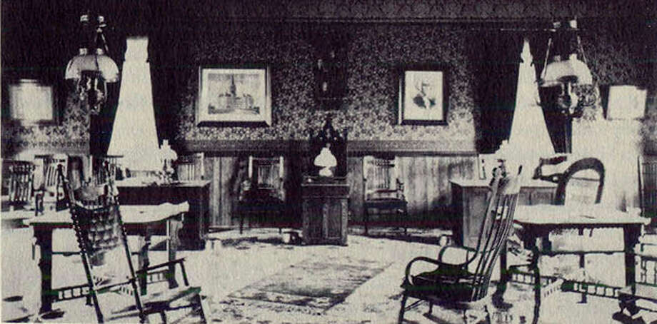 """The headquarters and meeting room on the second floor of the Church Street firehouse in New Milford had all the comforts of home in 1899. Photo: Courtesy Of """"Howard Peck's New Milford"""" / The News-Times Contributed"""