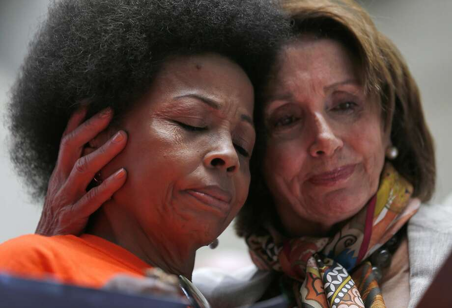 """Mattie Scott, with Healing 4 Our Families & Our Nation is embraced by Democratic Leader Nancy Pelosi after speaking about losing her son to gun violence during a """"family sit-in to disarm hate"""" event held by Pelosi, Congressman Mike Thompson, the Chair of the House Gun Violence Prevention Task Force along with victims of gun violence and other supporters of gun reform in the plaza next to the Zuckerberg San Francisco General Hospital and Trauma Center June 29, 2016 in San Francisco, Calif. Photo: Leah Millis, The Chronicle"""
