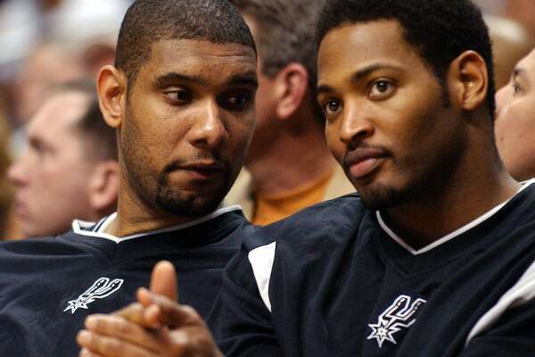 Spurs' Tim Duncan talks with teammate Robert Horry during Game # 3 of the Western Conference Semifinals Sunday May 9, 2004 against the Lakers at the Staples Center in Los Angeles, CA. The Lakers went on to win 105-81. PHOTO BY EDWARD A. ORNELAS/STAFF