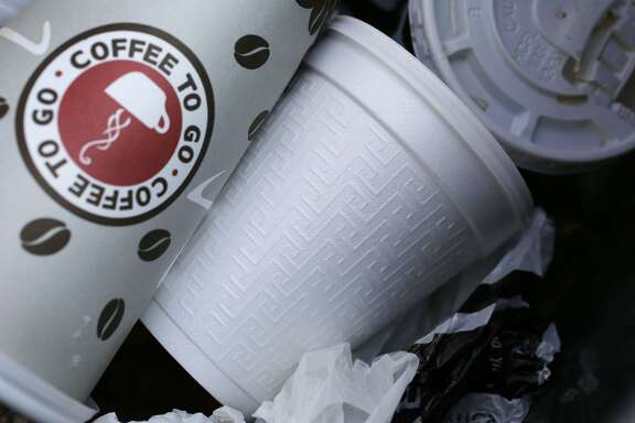 A foam cup, center, is discarded in a trash bin in New York Thursday, Feb. 14, 2013. New York Mayor Michael Bloomberg, who has taken on smoking, sugary drinks and salt, talked about banning food packaging made from polystyrene foam from stores and restaurants in his annual State of the City address on Thursday. (AP Photo/Mark Lennihan)