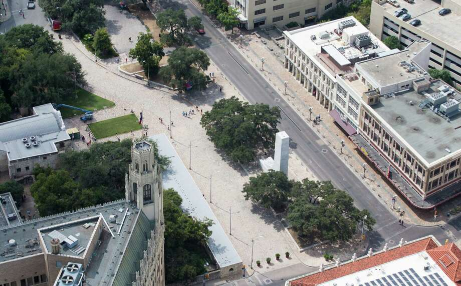 Alamo Plaza, with the Alamo on the left side of the image, is seen in a Thursday Oct. 8, 2015 aerial photo. The Emily Morgan hotel is in the lower left corner of the image, while the white marble cenotaph stands between two trees in the  middle of the plaza and three buildings the Texas General Land Office recently agreed to buy are seen on the right side of the frame. Photo: WILLIAM LUTHER, Staff / San Antonio Express-News / © 2015 San Antonio Express-News