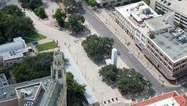 Alamo Plaza, with the Alamo on the left side of the image, is seen in a Thursday Oct. 8, 2015 aerial photo. The Emily Morgan hotel is in the lower left corner of the image, while the white marble cenotaph stands between two trees in the  middle of the plaza and three buildings the Texas General Land Office recently agreed to buy are seen on the right side of the frame.