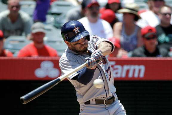 Houston Astros' Jose Altuve hits an RBI-triple against the Los Angeles Angels during the third inning of a baseball game Wednesday, June 29, 2016, in Anaheim, Calif. (AP Photo/Jae C. Hong)