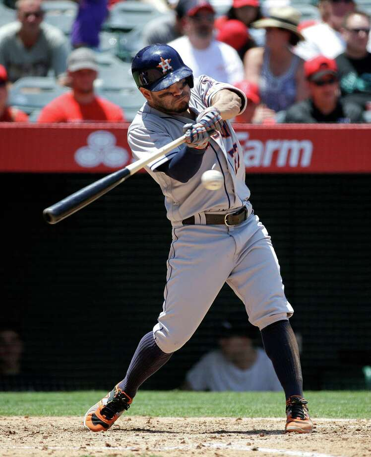 Houston Astros' Jose Altuve hits a RBI-triple against the Los Angeles Angels during the third inning of a baseball game Wednesday, June 29, 2016, in Anaheim, Calif. (AP Photo/Jae C. Hong) Photo: Jae C. Hong, Associated Press / Copyright 2016 The Associated Press. All rights reserved. This material may not be published, broadcast, rewritten or redistribu