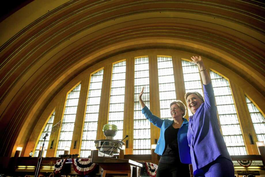 Democratic presidential candidate Hillary Clinton, accompanied by Sen. Elizabeth Warren, D-Mass., left, waves after speaking at the Cincinnati Museum Center at Union Terminal in Cincinnati, Monday, June 27, 2016. (AP Photo/Andrew Harnik) Photo: Andrew Harnik, STF / Copyright 2016 The Associated Press. All rights reserved. This material may not be published, broadcast, rewritten or redistribu