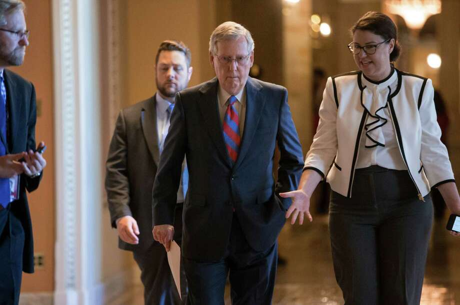 Senate Majority Leader Mitch McConnell of Ky. walks to the Senate chamber on Capitol Hill in Washington, Wednesday, June 29, 2016, as the Senate works on a rescue package for debt-stricken Puerto Rico, just two days before the island is expected to default on a $2 billion debt payment. The bill, passed by the House earlier this month, would create a control board that would oversee the island's finances and could supervise some debt restructuring. (AP Photo/J. Scott Applewhite) Photo: J. Scott Applewhite, STF / AP