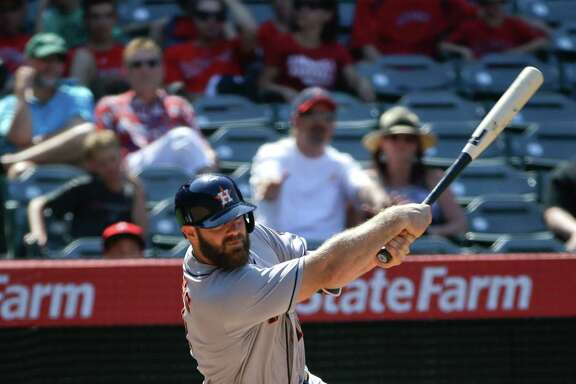Houston Astros' Evan Gattis hits a RBI-single during the ninth inning of a baseball game against the Los Angeles Angels, Wednesday, June 29, 2016, in Anaheim, Calif. (AP Photo/Jae C. Hong)