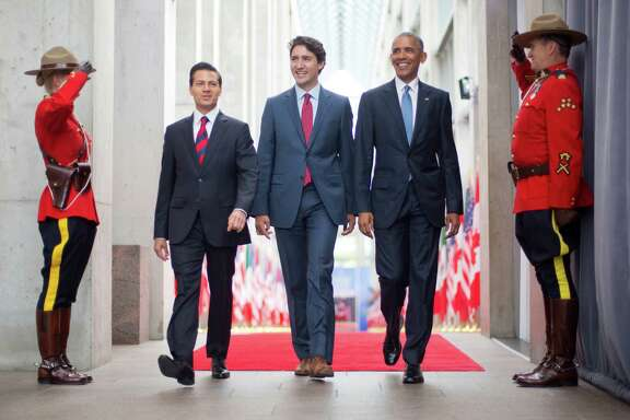 Mexican President Enrique Pena Neito, left, Canadian Prime Minister Justin Trudeau and President Barack Obama appear together at the National Gallery of Canada in Ottawa, Ontario, on Wednesday.