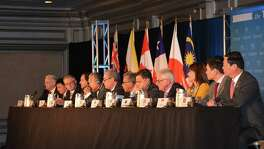 Trade ministers of the United States and 11 other Pacific Rim countries attend a press conference after negotiating the Trans-Pacific Partnership (TPP) trade agreement in 2015. The trade agreement between the United States and 11 Pacific basin nations threatens San Antonio and the U.S.-Mexico border economy by eroding the tax advantages of manufacturing in Mexico, according to a report by the Texas Fair Trade Coalition.