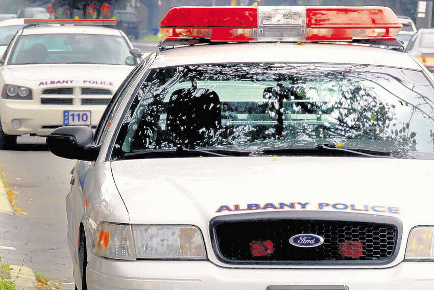 Albany Police cars parked on Western Avenue in Albany, New York 8/21/2009. (Michael P. Farrell / Times Union )