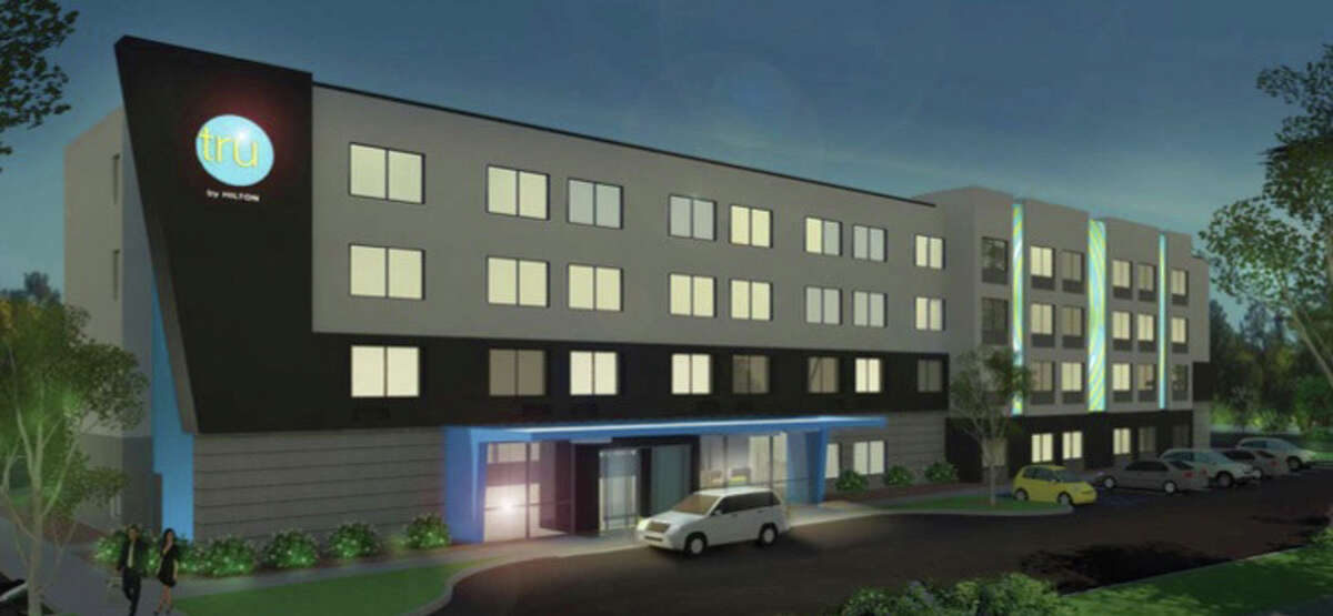 A four-story Tru by Hilton hotel is proposed for downtown Troy. The project is currently on hold.