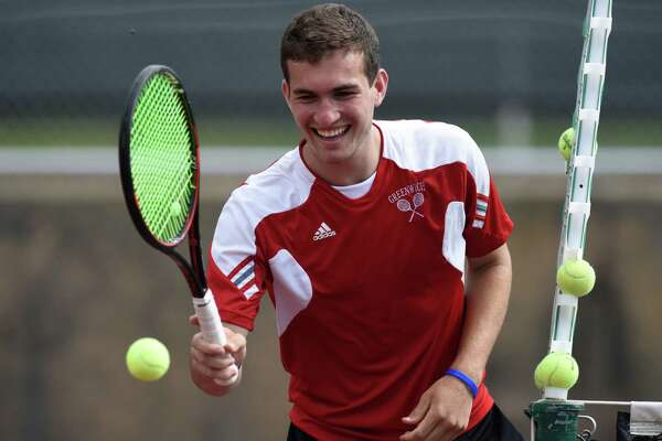 Greenwich High's Will Blumberg smiles between games during the No. 1 Cardinals' win over No. 5 Darien in the FCIAC semifinals on May 23. Enjoying an undefeated high school season, the nationally ranked Blumberg has been named the Hearst Connecticut Media Boys Tennis MVP.