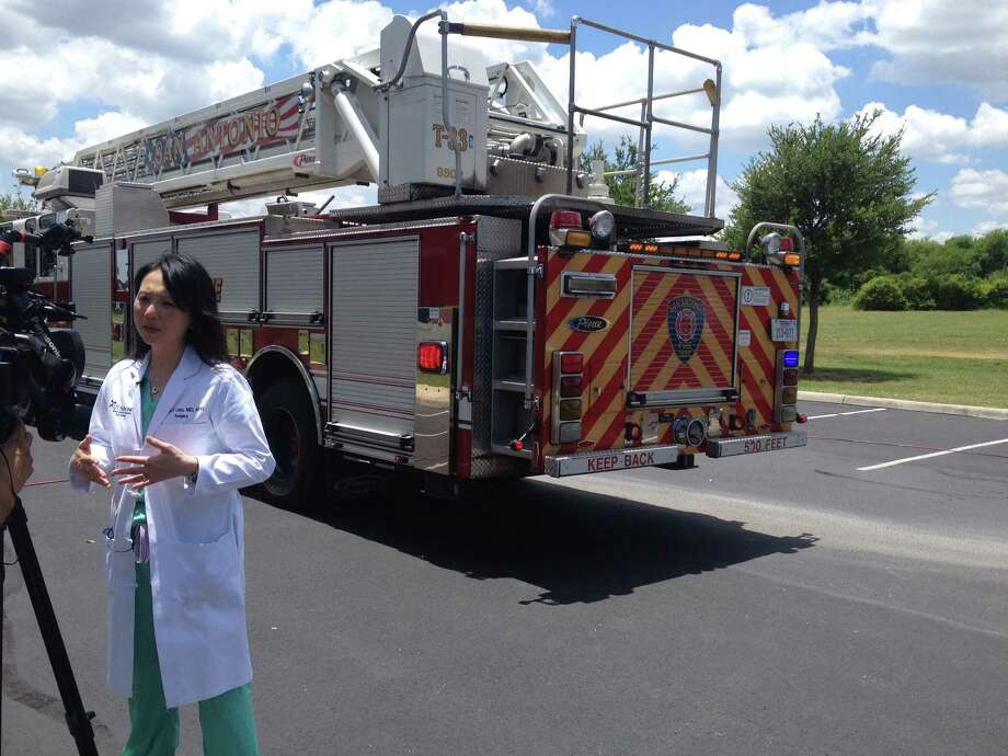 Dr. Lillian Liao, of the University of Texas Health System, talking to local reporters about the danger of leaving children in hot cars in the Texas heat. Liao said that even in 80-degree weather, it's only a matter of minutes before the heat starts affecting a child stuck in a car. Photo: Elizabeth Lepro / The San Antonio Express-News.