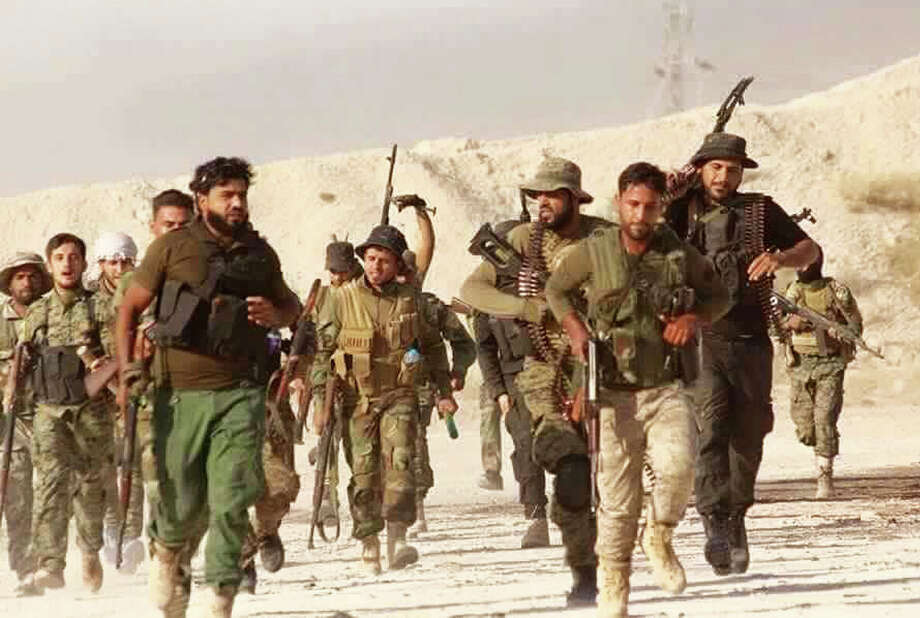 This photo shows U.S.-backed Syrian rebels of the New Syrian Army run in Syria. Islamic State militants on Wednesday pushed back the Syrian rebels from a town on the Iraqi border. Photo: Uncredited, HONS / Local Council of Daraya City