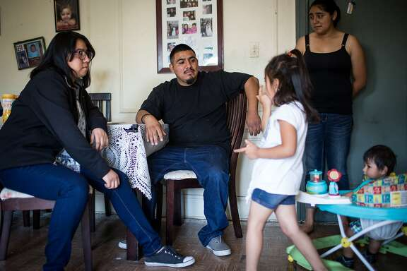 Juan Valentin, an undocumented immigrant, hangs out with his sisters, Valeria, left, Rosemarie, right, his daughter Jacqueline, center right, and son Miguel, far right, in his Stockton home.