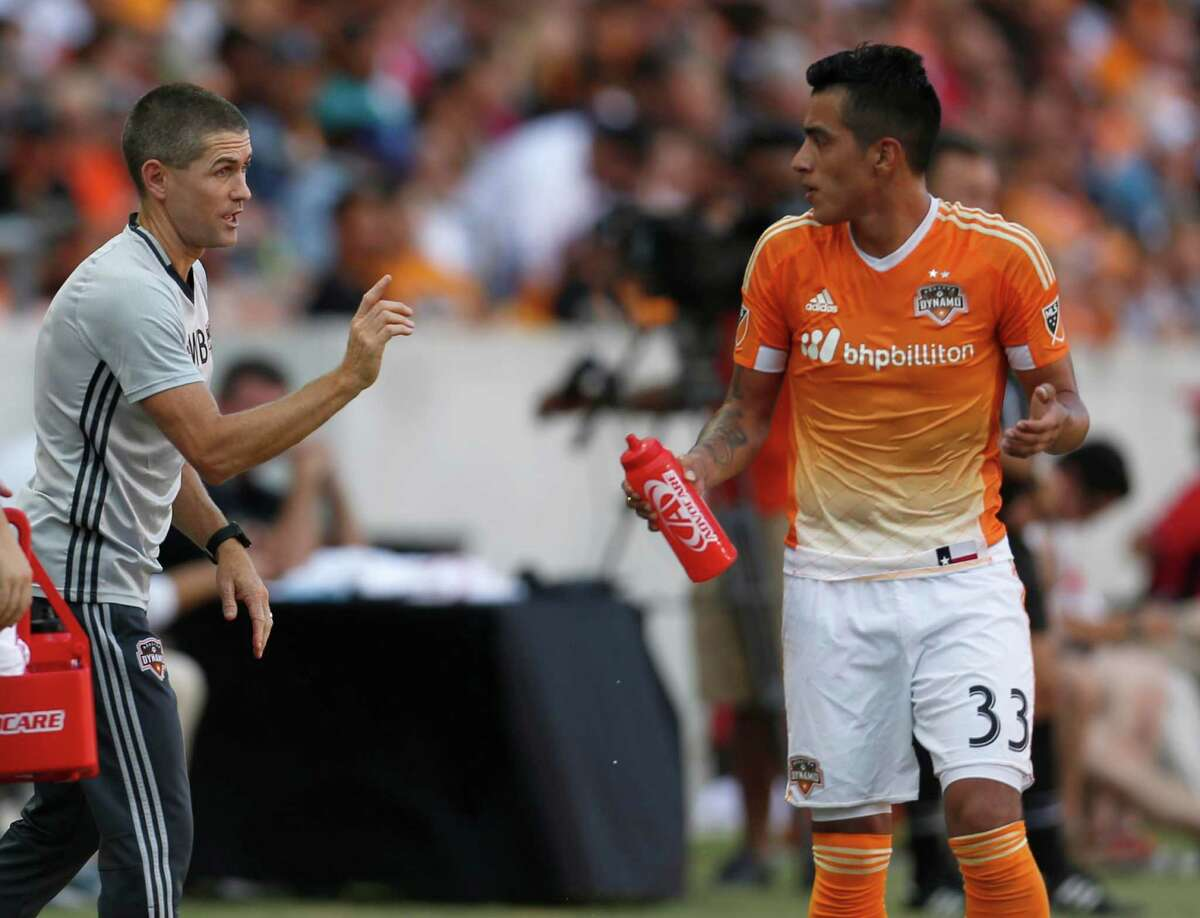 Houston Dynamo interim head coach Wade Barrett talks to Houston Dynamo midfielder Leonel Miranda (33) during the first half of the Lamar Hunt U.S. Open Cup Round of 16 at BBVA Compass Stadium, Wednesday, June 29, 2016, in Houston.