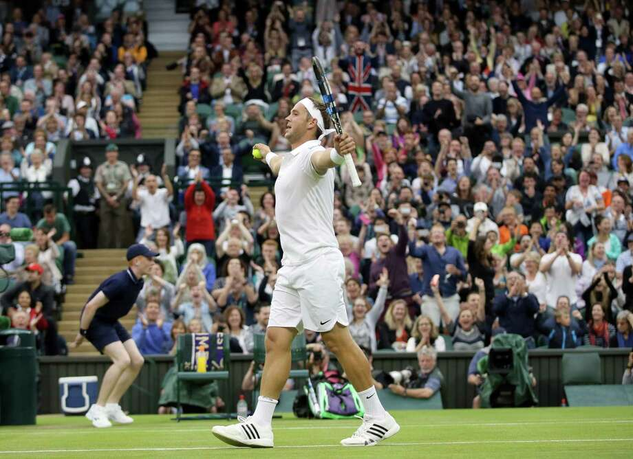 Marcus Willis of Britain celebrates after winning a point against Roger Federer of Switzerland during their men's singles match on day three of the Wimbledon Tennis Championships in London, Wednesday, June 29, 2016. (AP Photo/Tim Ireland) Photo: Tim Ireland, STF / Copyright 2016 The Associated Press. All rights reserved. This material may not be published, broadcast, rewritten or redistribu