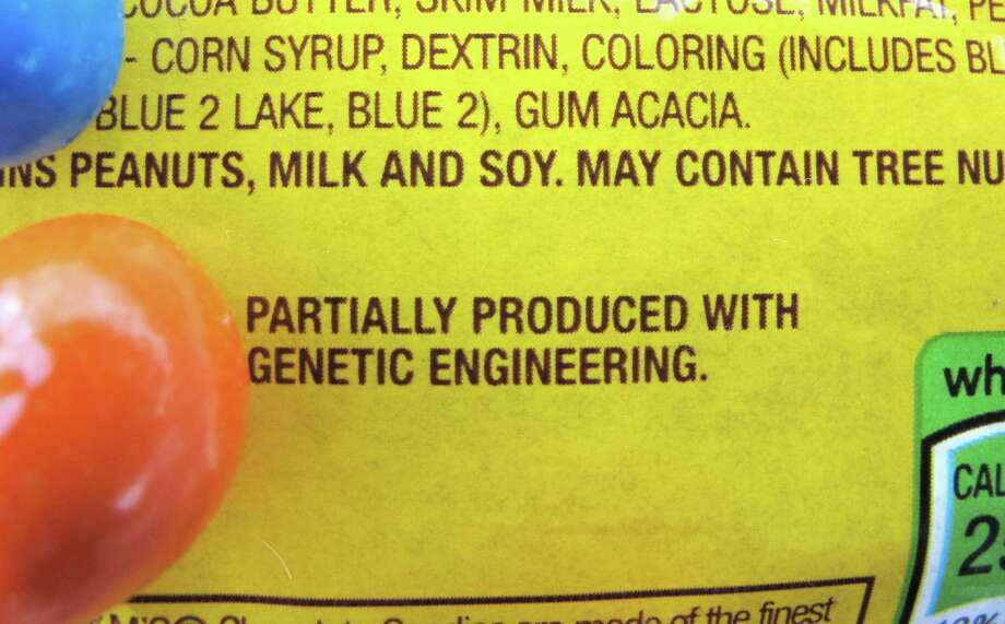 """FILE - This April 8, 2016 file photo shows a new disclosure statement which reads, """"PARTIALLY PRODUCED WITH GENETIC ENGINEERING"""" on a package of candy in Montpelier, Vt. On Friday, July 1, 2016, Vermont will become the first U.S. state to require the labeling of foods made with genetically modified ingredients. (AP Photo/Lisa Rathke) Photo: Lisa Rathke, STF / Copyright 2016 The Associated Press. All rights reserved. This material may not be published, broadcast, rewritten or redistribu"""