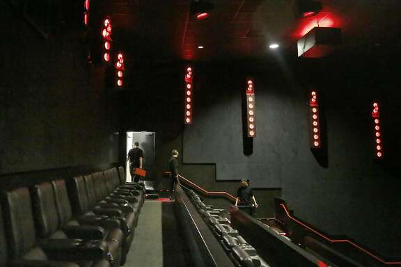 A view of the new Dolby cinema technology in one of the theaters at AMC in Newpark Mall on Wednesday, June 29, 2016, in Newark, Calif. All red lights on the numerous bars surround the walls around the full circumference of the theater with hanging speakers on the ceiling above.  Reserved recliners in foreground not only recline but pulsate according to story line.