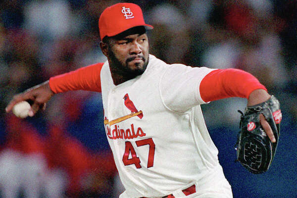 FILE PHOTO: St. Louis Cardinals reliever Lee Smith pitches in St. Louis in this 1993 file photo.