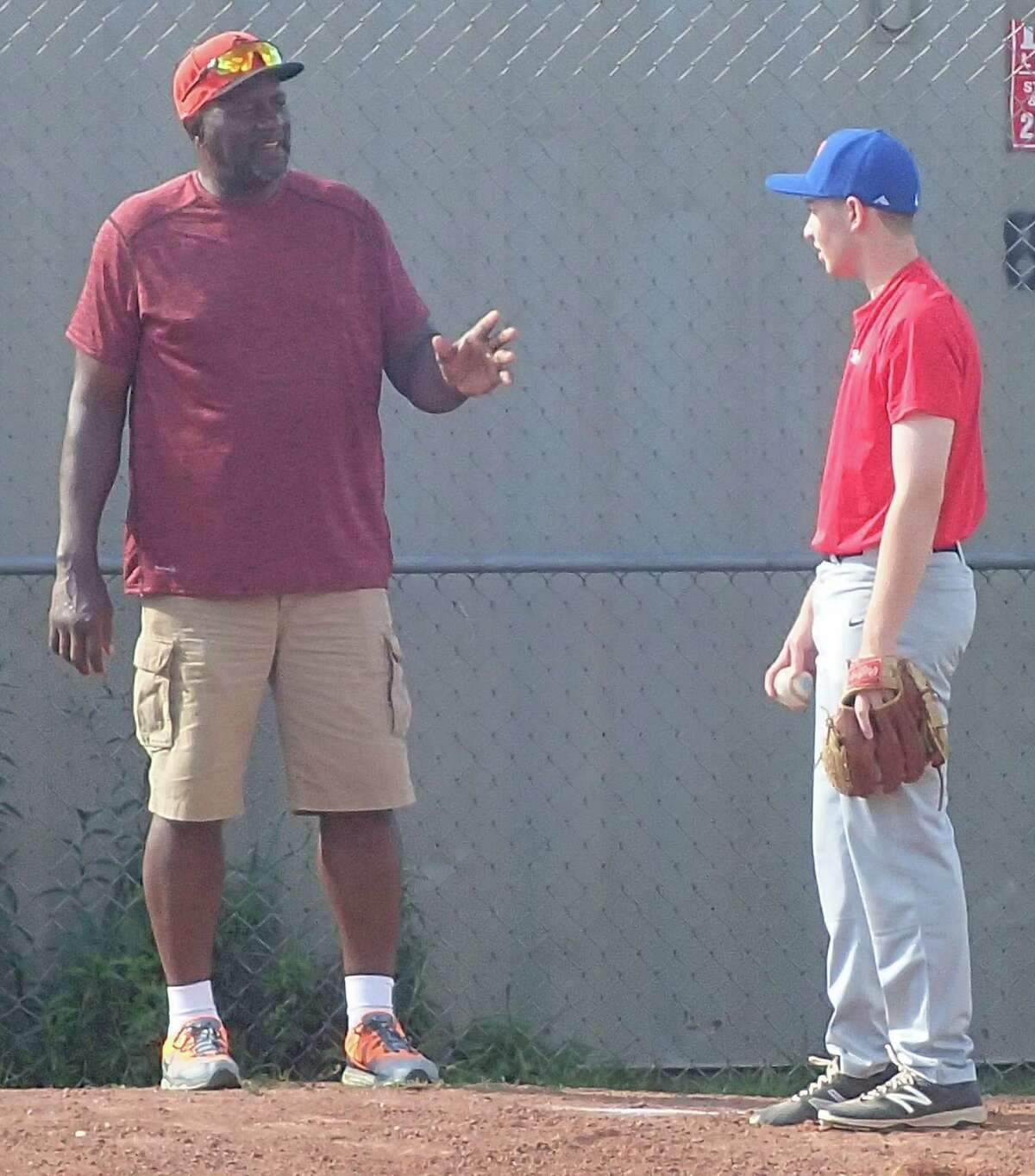 Danbury resident and former big-league relief pitcher Lee Smith, left, works with Derek Ross, a 16-year-old Immaculate High School student, during a baseball clinic hosted by the Danbury Westerners and the Danbury Youth Baseball Association at Rogers Park in Danbury June 29, 2016.