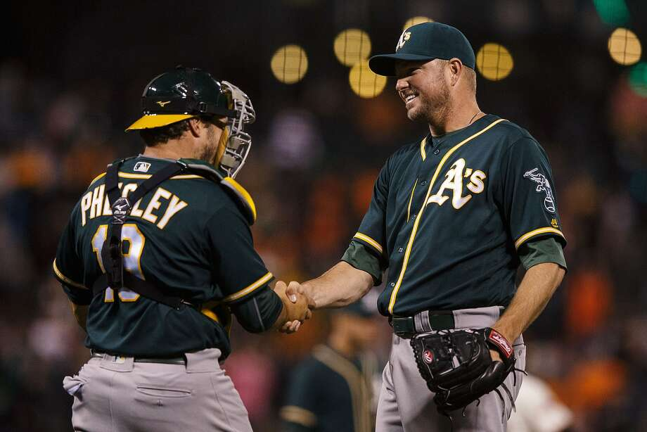 SAN FRANCISCO, CA - JUNE 28: Ryan Madson #44 of the Oakland Athletics celebrates with Josh Phegley #19 after the game against the San Francisco Giants at AT&T Park on June 28, 2016 in San Francisco, California. The Oakland Athletics defeated the San Francisco Giants 13-11.  (Photo by Jason O. Watson/Getty Images) Photo: Jason O. Watson, Getty Images