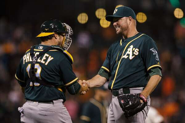 SAN FRANCISCO, CA - JUNE 28: Ryan Madson #44 of the Oakland Athletics celebrates with Josh Phegley #19 after the game against the San Francisco Giants at AT&T Park on June 28, 2016 in San Francisco, California. The Oakland Athletics defeated the San Francisco Giants 13-11.  (Photo by Jason O. Watson/Getty Images)