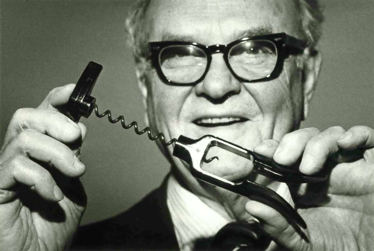 Herbert Allen in 1980 with his invention, the Screwpull. Allen spent two years developing the wine opener, applying engineering principles and working from the basement of his River Oaks home. .