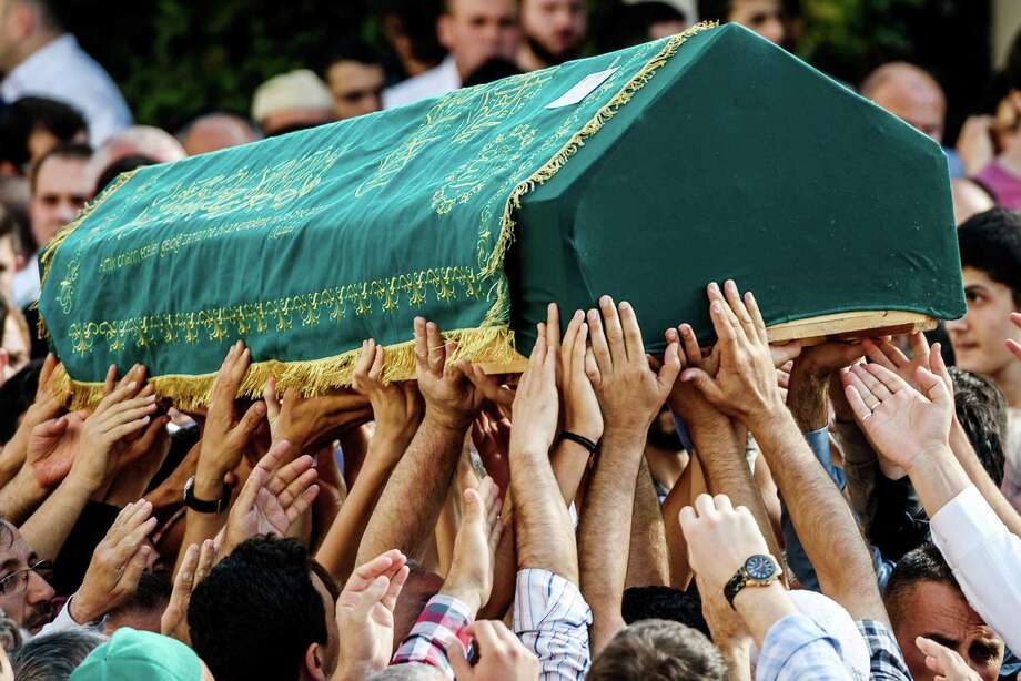 The coffin of a victim of the Istanbul airport attack is carried at a funeral Wednesday. The death toll in the terrorist attack rose to 42. Story on Page A15 Photo: OZAN KOSE, Stringer / AFP or licensors