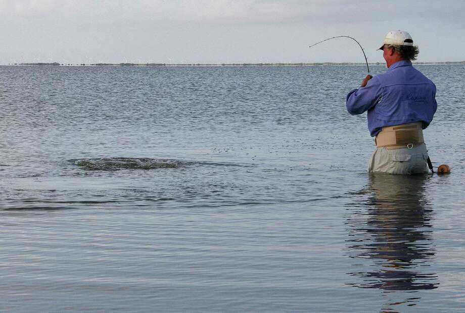 Wadefishing in coastal waters, hugely popular during summer, is one of the ways Texans can be exposed to Vibrio vulnificus, a saltwater bacteria that causes 15-30 life-threatening infections each year in the state. Photo: Shannon Tompkins