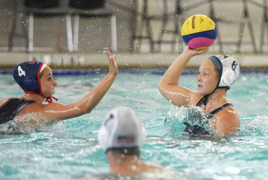 Maddie Musselman, left, defends Courtney Mathewson during the U.S. Olympic women's water polo team's practice at the YMCA of Greenwich on Wednesday. The team had an open morning practice and scrimmaged Hungary in front of a sold-out crowd Wednesday night as part of preparations for the Olympics in Rio de Janeiro. Photo: Tyler Sizemore / Hearst Connecticut Media / Greenwich Time