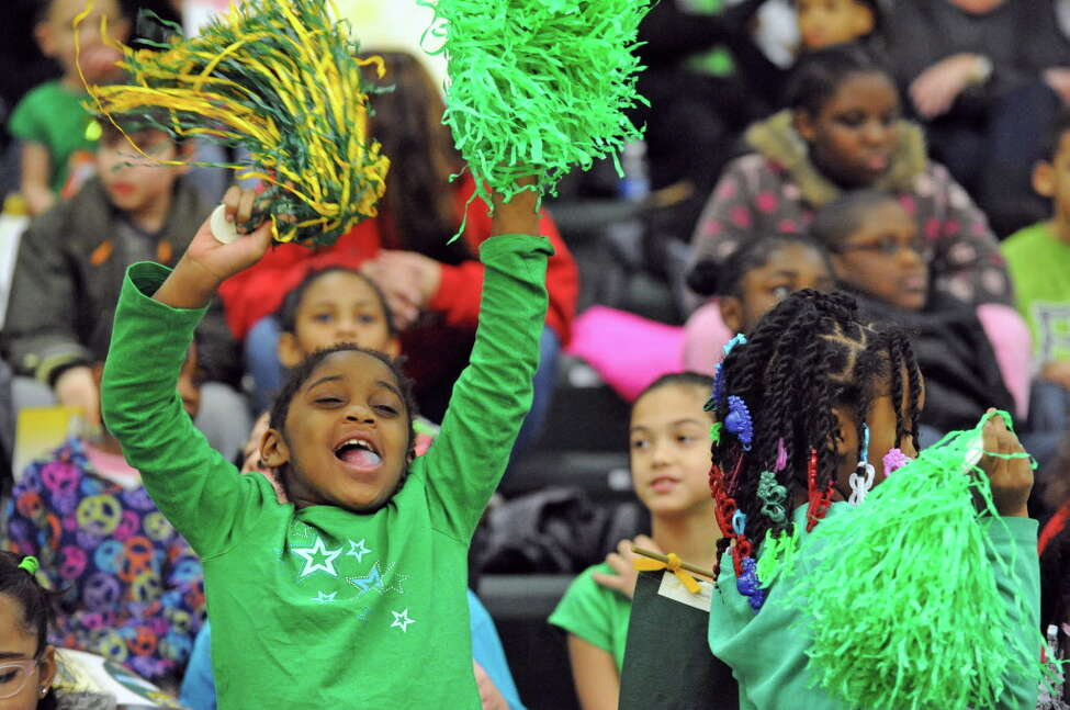 Second grade student Ava Horne with classmates from Philip Schuyler Academy cheers on the Siena women's team during their game against Monmouth during