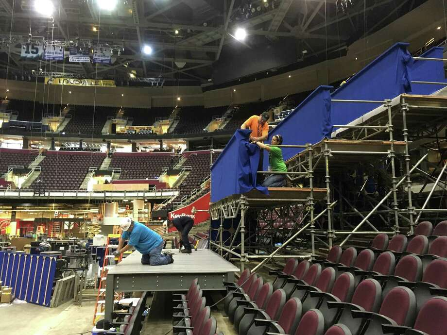 Workers prepare a camera platform inside Quicken Loans Arena for the Republican National Convention on June 28, in Cleveland. There are still many unknowns with guests and scheduling. Photo: Mark Gillispie, STF / aP