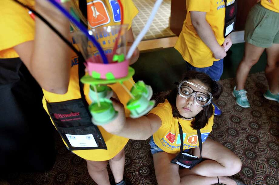 Eve Hindes 14, of Chatham, right, makes a final inspection of her team's spacecraft during the ExxonMobil Bernard Harris Summer Science Camp on Wednesday, June 29, 2016, at Rensselaer Polytechnic Institute in Troy, N.Y. Thirty-six middle school students, who are exploring the world of science, technology, engineering and math, created spacecrafts and dropped them from a designated height to mimic the impact and shock of a planetary landing. (Cindy Schultz / Times Union) Photo: Cindy Schultz / Albany Times Union