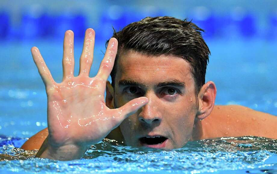 After winning the 200-meter butterfly, Michael Phelps knows that a trip to Rio de Janeiro will be added to ones to London, Beijing, Athens and Sydney to make him the first five-time Olympian among male swimmers. Photo: Mark J. Terrill, STF / Copyright 2016 The Associated Press. All rights reserved. This material may not be published, broadcast, rewritten or redistribu