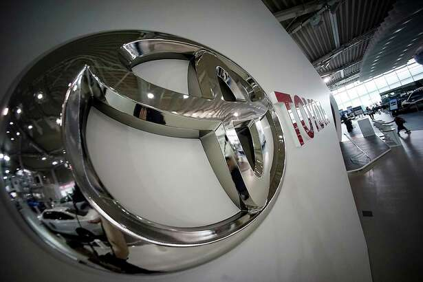 Toyota logo is seen at a Toyota showroom in Tokyo, Wednesday, June 29, 2016. Toyota is recalling 1.43 million vehicles globally for defective air bags that aren't part of the massive recalls of Takata air bags, the Japanese automaker said Wednesday. (AP Photo/Eugene Hoshiko)