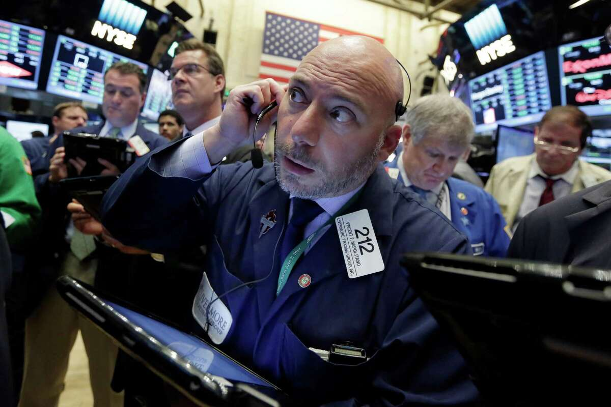 Trader Vincent Napolitano, center, works on the floor of the New York Stock Exchange, Wednesday, June 29, 2016. Stocks are opening broadly higher on Wall Street as global markets continue to recover following Britain's vote to make a break with the European Union. (AP Photo/Richard Drew)