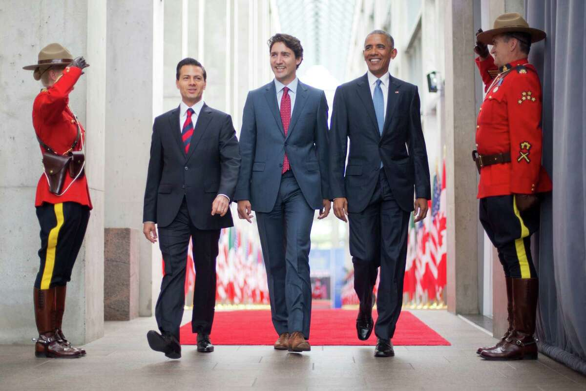 President Barack Obama walks with Canadian Prime Minister Justin Trudeau and Mexican President Enrique Pena Neito at the National Gallery of Canada in Ottawa, Canada, Wednesday, June 29, 2016. Obama traveled to Ottawa for the North America Leaders' Summit. (AP Photo/Pablo Martinez Monsivais) ORG XMIT: CANM110
