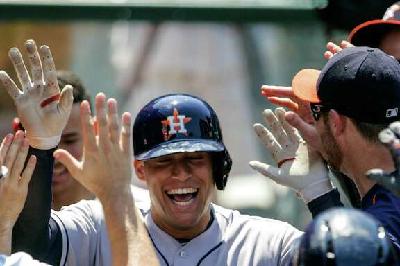 ANAHEIM, CA - JUNE 29: George Springer #4 of the Houston Astros celebrates with teammates in the dugout after hitting a homerun and scoring in the 6th inning against the Los Angeles Angels at Angel Stadium of Anaheim on June 29, 2016 in Anaheim, California. (Photo by Kent Horner/Getty Images)