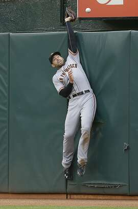 San Francisco Giants right fielder Mac Williamson can't make the catch on a two-run home run by Oakland Athletics' Jed Lowrie during the third inning of a baseball game Wednesday, June 29, 2016, in Oakland, Calif. (AP Photo/Ben Margot)