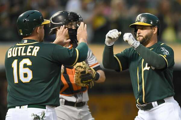OAKLAND, CA - JUNE 29:  Yonder Alonso #17 of the Oakland Athletics is congratulated by Billy Butler #16 after Alonso hit a two-run homer against the San Francisco Giants in the bottom of the fourth inning at O.co Coliseum on June 29, 2016 in Oakland, California.  (Photo by Thearon W. Henderson/Getty Images)