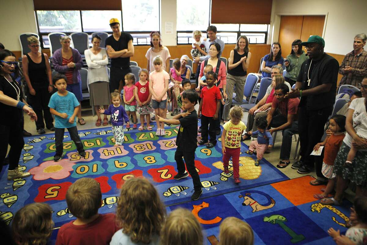 Owen Nguyen, 7, of Berkley dances during Alphabet Rockers let dance off on Tuesday, June 28, 2016 at the Oakland Public Library in Oakland, California. They use their songs to teach kids about music and hip hop, as well as nutrition, bullying, race and friendship.