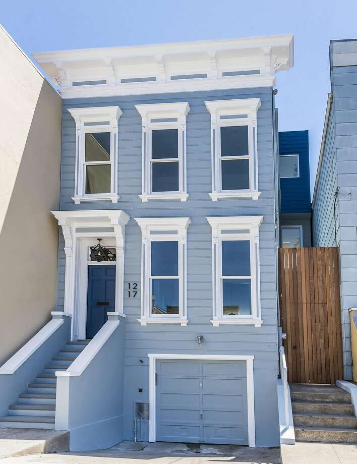 1217 York St. is a fully renovated three-bedroom rowhouse originally built in 1875. Photo: Olga Soboleva / Vanguard Properties