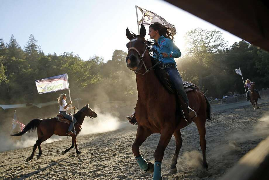 Katie Nachtshem (right) and Bria Michelsen during rehearsal of the grand entry for the Woodside Junior Rodeo. Photo: Scott Strazzante, The Chronicle